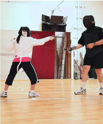 Fencing Teacher and Student